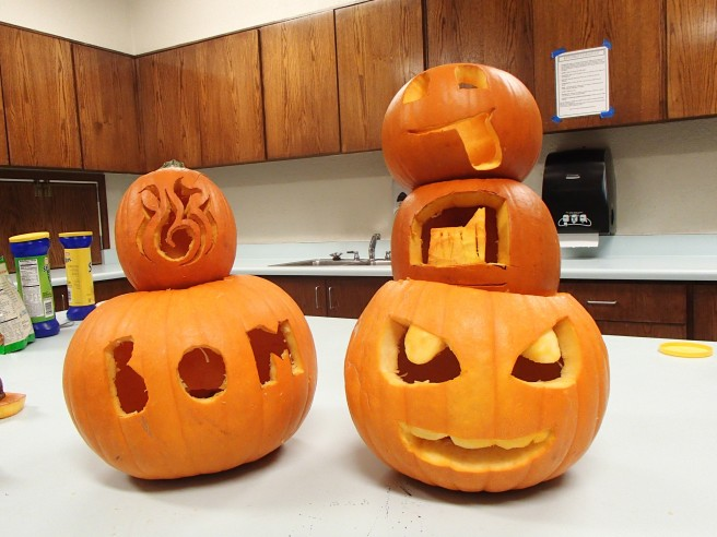 Our District's carved pumpkins... Mine is the silly face on the top right. Couldn't quite get the tongue shape right. :)